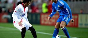 Sevilla's Jose Antonio Reyes (L) fighting for the ball against Real Madrid' Cristiano Ronaldo at the Ramon Sanchez Pizjuan Stadium on Mar 26, 2014. Sevilla won 2-1.