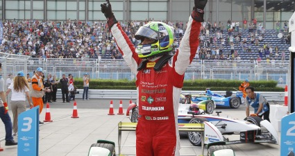 as di Grassi celebrates winning the first ever Formula E race in Beijing.